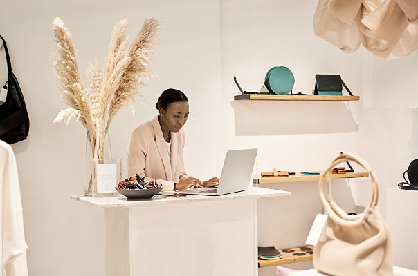 store manager using laptop