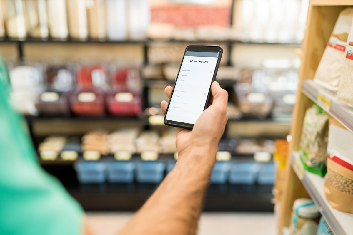 Man using mobile phone in grocery store